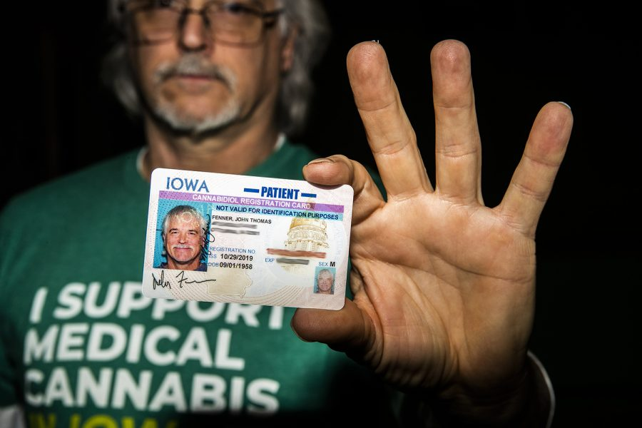 John Fenner holds his cannabidiol registration card at the Adler Journalism Building on Feb. 25. The card is used for purchasing CBD and THC products at Iowa dispensaries.