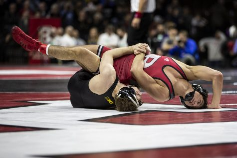 Iowa's 125-pound Spencer Lee grapples with Rutgers'  Nicolas Aguilar during session one of the Big Ten Wrestling Tournament in Piscataway, NJ on Saturday, March 7, 2020. Lee won by fall in 2:53. (Nichole Harris/The Daily Iowan)
