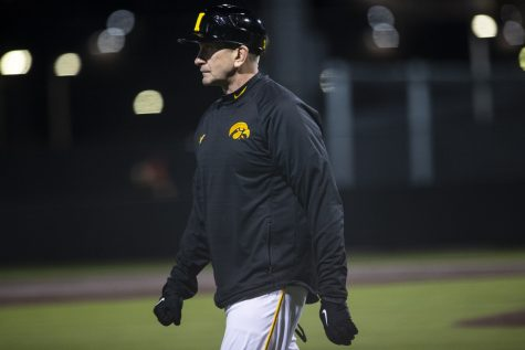 Iowa head coach Rick Heller watches the game from third base during a baseball game between Iowa and Grand View on March 3, 2020. The Hawkeyes defeated the Vikings 15-2. (Nichole Harris/The Daily Iowan)