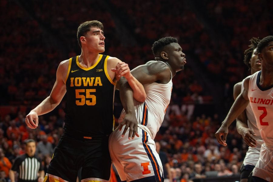 Iowa center Luka Garza is blocked by Illinois Center Kofi Cockburn during a game against the University of Illinois on Sunday, March, 8, 2020 at the State Farm Center in Champaign, Illinois. The Hawkeyes lost to the Fighting Illini, 76-78. (Emily Wangen/The Daily Iowan)