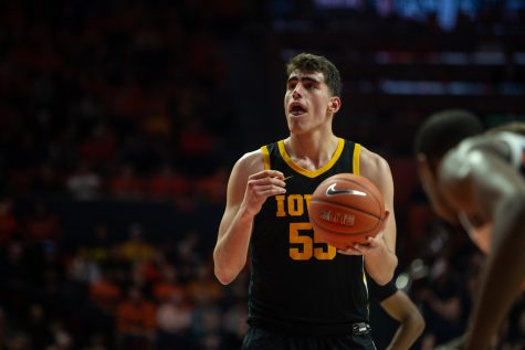 Iowa center Luka Garza prepares to make a free throw during a game on March 8 at the State Farm Center in Champaign, Illinois.