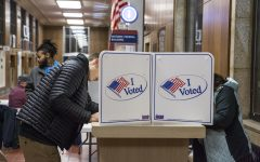 Voters fill out their ballots at a polling location in the Historic Dubuque Federal Building in Dubuque on Tuesday Nov. 6, 2018.