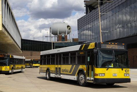 Cambuses pick up and drop off passengers at the WCTC stop on Monday, April 20, 2020.