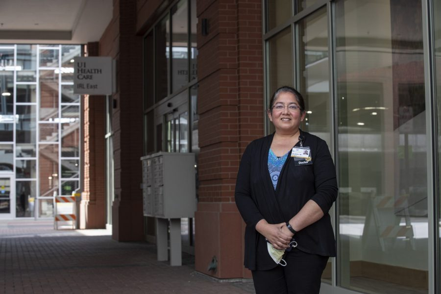 Alka Walter poses for a potrait in front of the UI Health Care Iowa River Landing East Clinic on Wednesday, April 22, 2020. Walter is a clinical assistant professor in the UI Carver College of Medicine and serves as the Congolese Health Partnership co-chair.