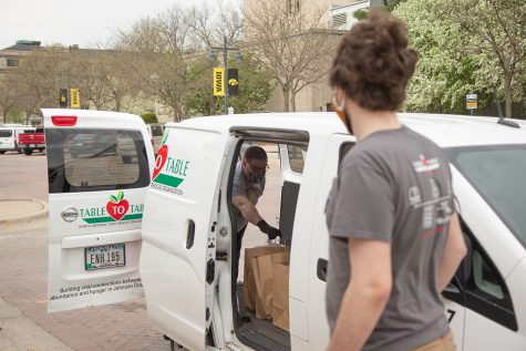 Table to Table program Assistant Andrew Winkers oversees a delivery from St. Burch Tavern for the Food with Love Program on Tuesday, April 28, 2020. The program supplies hot meals to shelters in Iowa City while reimbursing the resterants that participate.