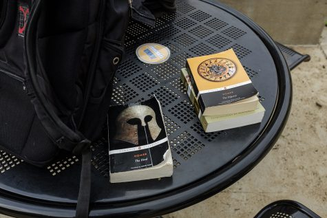 Copies of various works of literature from Homer sit on a table during the Homerathon on the T. Anne Cleary walkway on Wednesday, March 27, 2019.