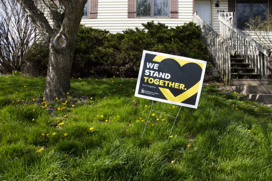 A yard sign is seen in front of a home on Tuesday, April 21. These signs, which were distributed by UIHC, are on display in front of houses and businesses across Iowa City. (Jenna Galligan/The Daily Iowan)