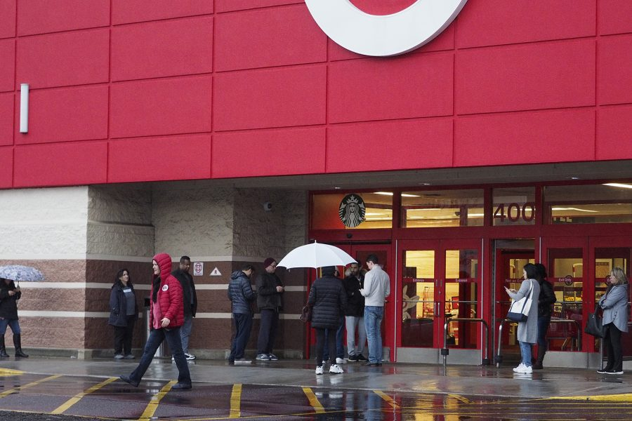 People wait at the door before 8 a.m. for Target in Milltown to open as the coronavirus spreads thoughout New Jersey.  Friday, Mar. 13, 2020. (TNS)