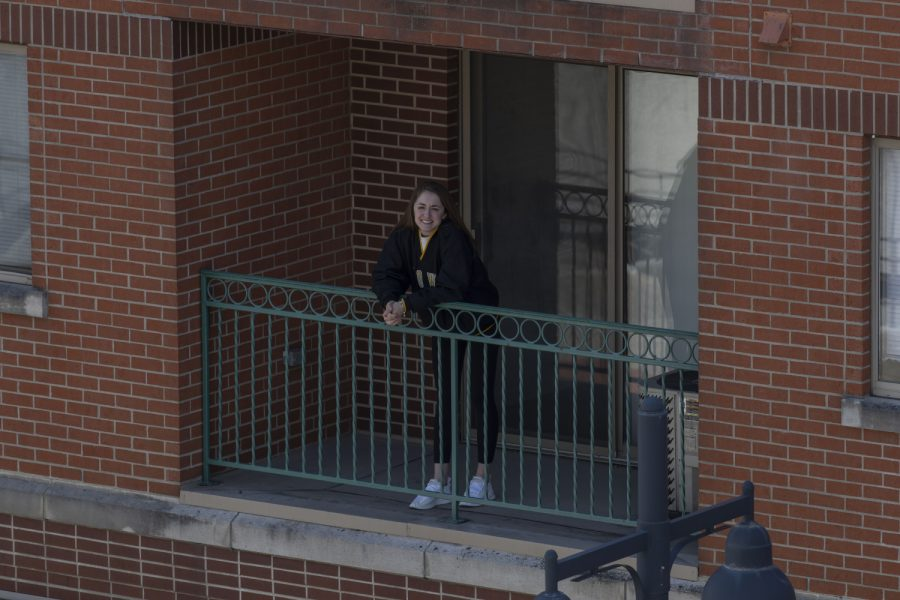 Nina Grover, a third-year UI student, poses for a portrait on the balcony of her apartment on Monday, April 20, 2020. (Jake Maish/The Daily Iowan)