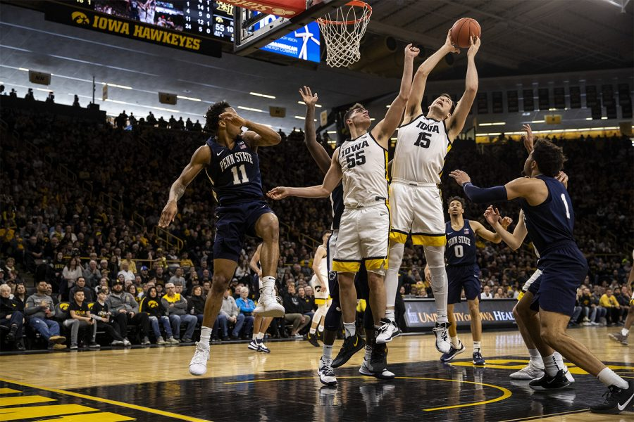 Iowa forward Ryan Kriener and Iowa guard Luka Garza fight for the rebound during a men's basketball game between Iowa and Penn State on Saturday, Feb. 29 at Carver-Hawkeye Arena. The Hawkeyes defeated the Nittany Lions 77-68.