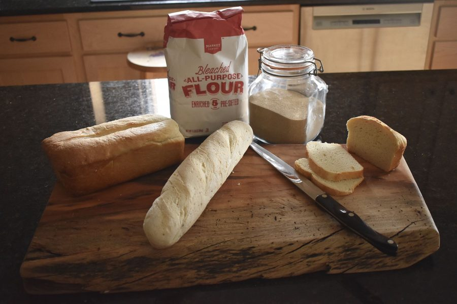 A buttermilk loaf is pictured alongside a variation of French baguette and classic white bread on Wednesday April 15, 2020. The type of flour and yeast used had a sizable effect on the outcome of the bread. Flour can affect the flavor of the bread while yeast can affect the texture and the proof of the bread.