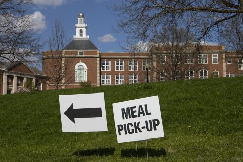 Signs offering directions for meal pickup are seen at City High School on Sunday, April 26, 2020.
