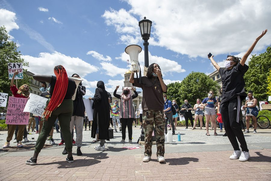 Sisters Raneem Hamad and Lujayn Hamad (right) lead chants during the Say Their Names rally on the Pentacrest on Saturday, May 30, 2020. Iowa City community members gathered to remember George Floyd, Ahmed Arbury, Yassin Mohamed and others. Money was collected during the event which went in donation to a vehicle procession carrying protesters going to Minneapolis. There were about five vehicles leaving directly following the rally.