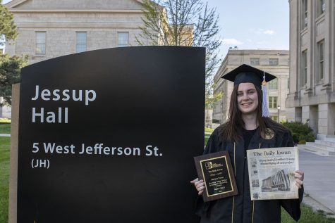 Marissa Payne poses outside Jessup Hall, where the UI central administration works, with her investigative reporting award on May 9, 2020. She earned the Iowa Newspaper Association's honor for her April 2019 Modern Piping scoop on the Pharmacy Building change order and thought this photo summed up her relationship with the UI.