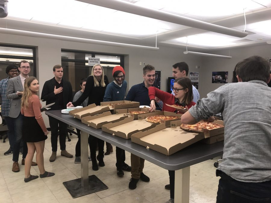 Like vultures, the DI staff descends upon election night pizza before covering the 2018 midterms on Nov. 6, 2018.