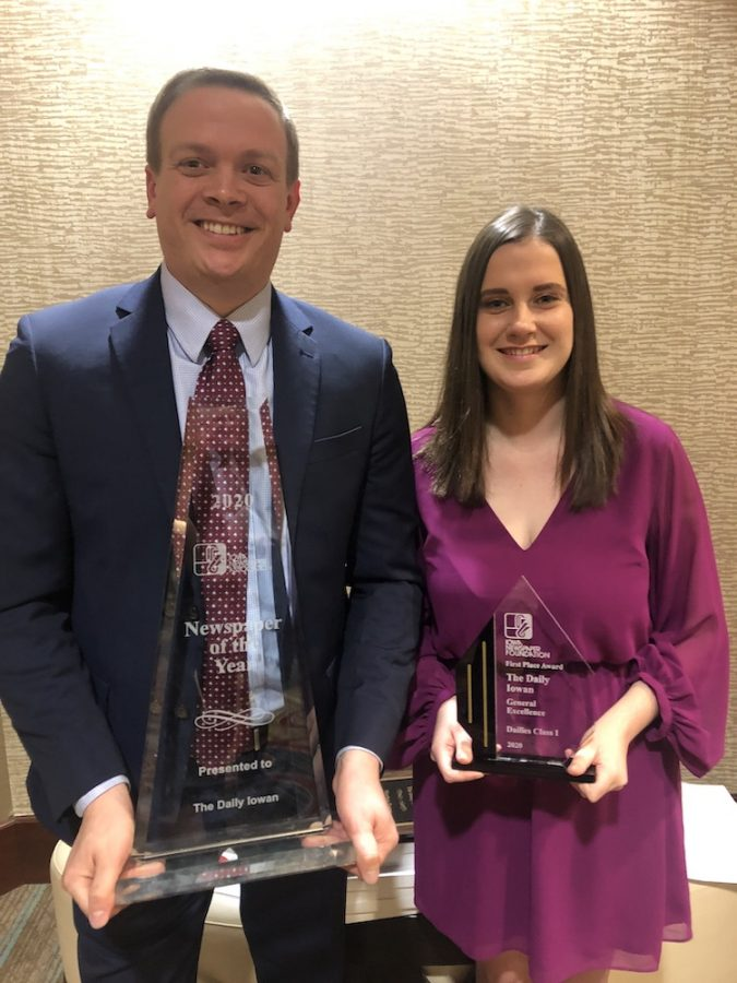 DI Publisher Jason Brummond and DI editor Marissa Payne hold the DI's Newspaper of the Year and General Excellence trophies at the Iowa Newspaper Association Convention in Des Moines on Feb 7, 2020.