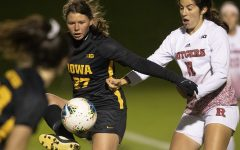 Iowa forward Samantha Tawharu fends off Rutgers midfielder Gabby Provenzano during the Iowa v Rutgers soccer game at the Iowa Soccer Complex on Friday, October 11, 2019. The Hawkeyes fell to the Scarlet Knights 0-1.