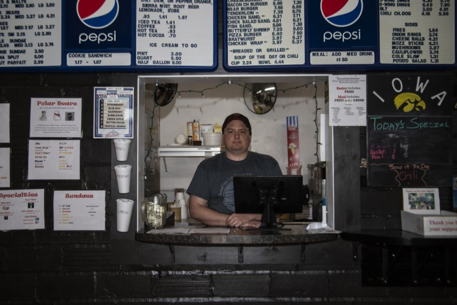 """Steven Grace poses for a portrait at Main Street Sweets in West Branch on Friday, May 1, 2020. Grace, co-owner of the restaurant, said as a business owner it is important to be adaptable and as restrictions change """"we'll play it by ear."""""""