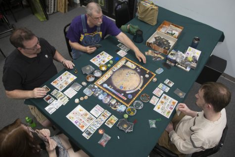 Board game club attendees play a game at Hobby Corner located in the Sycamore Mall on Thursday, June 6, 2019.