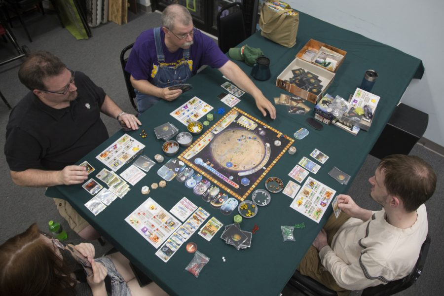 Board+game+club+attendees+play+a+game+at+Hobby+Corner+located+in+the+Sycamore+Mall+on+Thursday%2C+June+6%2C+2019.