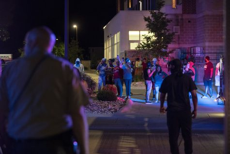 A crowd gathers outside of Coral Ridge Mall in Coralville on Sunday, May 31, 2020. Social media posts circulated Twitter and Facebook encouraging looters to break into the mall at 10:30 p.m. Police blocked the entrances and the crowd became violent as a man rushed an officer and police used pepper spray and flash bangs on the crowd. Several nearby businesses had property damage to windows and some protesters were handcuffed.