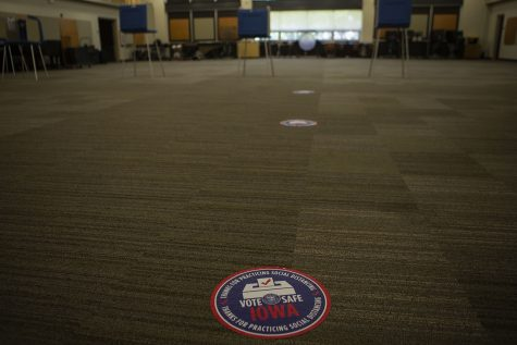 Stickers on the floor encouraging social distancing are seen on the floor on Tuesday, June 2 in Iowa City West High School.