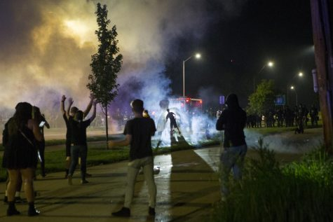 Law enforcement officers use tear gas and flash-bangs on protesters marching toward I-80 in Iowa City Wednesday night
