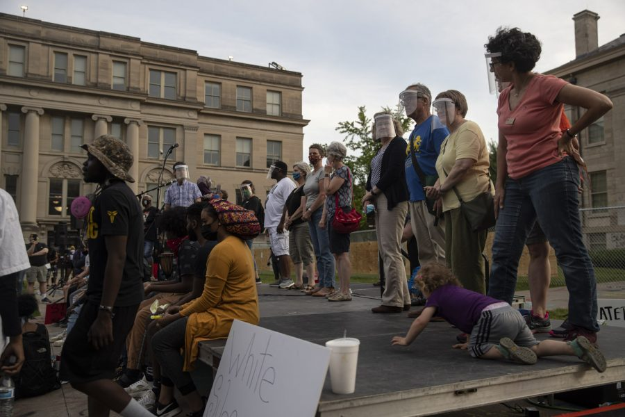 Iowa Sen. Joe Bolkcom, D-Iowa City, was the first elected official to address a crowd of protesters from a stage on the Pentacrest prior to the start of a march to support the Black Lives Matter movement and protest police brutality on Saturday, June 6 in Iowa City. The stage was positioned about 20 feet in front of a fence that was built to block off the Old Capitol after protesters had spray painted it during the week's earlier protests. It was the sixth straight night that a march was held in Iowa City and elected officials from the city, county and state levels lined up on the stage to speak to the demands of the protesters prior to the beginning of the march.