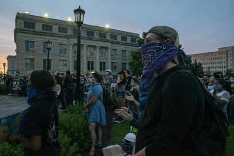 Protesters return to the Old Capitol after marching through downtown Iowa City as part of another protest on Monday, June 8th, 2020. Iowa City along with a majority of the country has been protesting the murder of George Floyd and systemic racism in the police force.