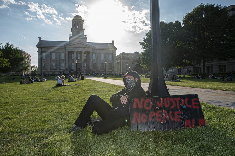An anonymous Iowa CIty citizen poses for a portrait in front of the Old Capitol Building while waiting for the next march to start on Sunday, June 14th, 2020. Iowa City, along with several other major cities across the country has spent the past few weeks protesting the murder of Geroge Floyd at the hands of the police and systemic racism.
