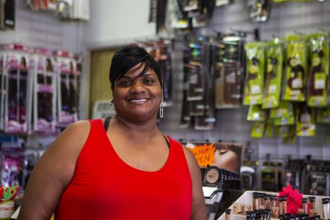 Denise Chambers, owner of Christina's Unity Beauty Supply, poses for a portrait on Thursday, June 18 inside the shop. The store sells wigs, lashes, extensions, and other beauty products.