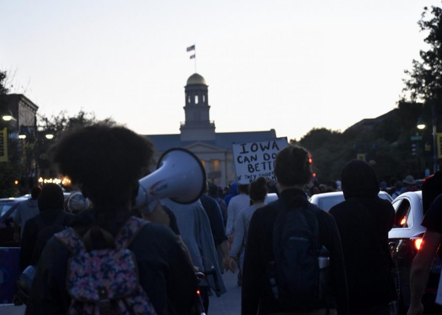 Protesters march up Iowa Avenue to the old Capitol during a Black Lives Matters March on June 23.