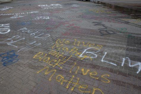 Graffiti on the intersection of Iowa Avenue and Dubuque Street is seen on June 4.