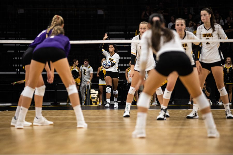 Iowa setter Brie Orr serves the ball during a volleyball match between Iowa and Washington at Carver Hawkeye Arena on Saturday, September 7, 2019. The Hawkeyes were defeated by the Huskies, 3-1.