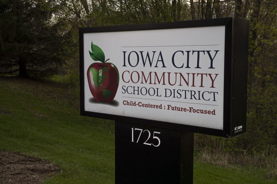 A sign for the Iowa City Community School District is seen outside the district's administration building on Tuesday, April 28.