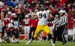 Iowa defensive end A.J. Epenesa celebrates tackling Nebraska quarterback Adrian Martinez during the football game against Nebraska at Memorial Stadium on Friday, November 29, 2019. The Hawkeyes defeated the Cornhuskers 27-24. Epenesa had two sacks throughout the game.