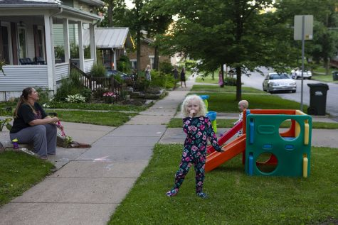 Kristine Djerf howls with her children, Sylvia and Oscar, on Tuesday, June 16, 2020 at their home in the Northside in Iowa City. Every night at 8 residents in the neighborhood stand outside and howl together for a few minutes to raise morale.