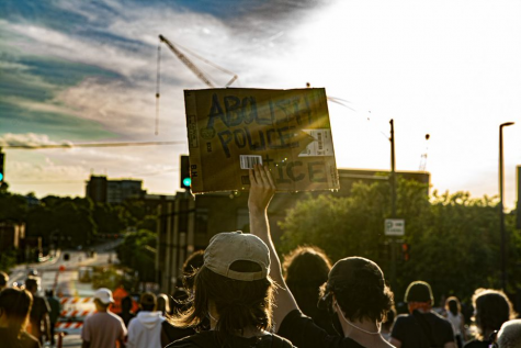 Iowa City citizens march through downtown as part of a protest on Sunday, June 14, 2020. Iowa City, along with several other major cities across the country, has been a center for protesting systemic racism and the murder of George Floyd at the hands of police.