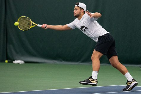 Iowa's Will Davies hits a forehand during a men's tennis match between Iowa and Nebraska-Omaha at the HTRC on Saturday, Jan. 25, 2020. The Hawkeyes defeated the Mavericks, 6-1.