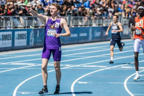 Johnston High School's Joe Schaefer celebrates his win in the boys' 800m race at the 2019 Drake Relays in Des Moines, IA, on Friday, April 26, 2019. (Shivansh Ahuja/The Daily Iowan)