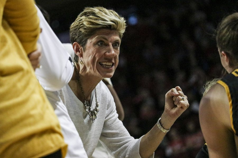 Iowa associate head coach Jan Jensen rallies the Iowa Hawkeyes during a timeout pep talk during a women's basketball game between Iowa and Nebraska at Pinnacle Bank Arena in Lincoln, Nebraska on Saturday, December 28. The Hawkeyes fell to the Huskers 78-69.
