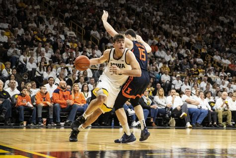Iowa center Luka Garza attempt to push past Illinois forward Giorgi Bezhanishvili during a men's basketball game between the Iowa Hawkeyes and the Illinois Fighting Illini on Sunday, February 2, 2020. The Hawkeyes defeated the Fighting Illini 72-65.