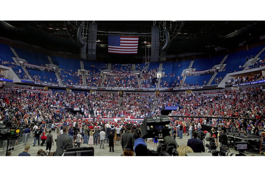People listen to President Donald Trump speaks during a rally at the BOK Center in Tulsa, Okla., Saturday, June 20, 2020. [Sarah Phipps/The Oklahoman]
