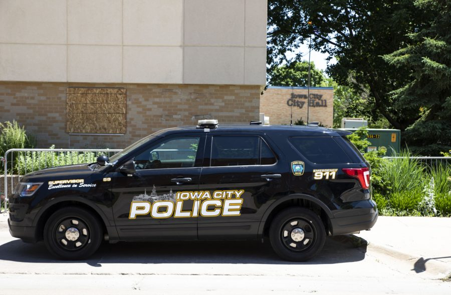 An Iowa City Police vehicle is seen outside City Hall on Monday, June 8, 2020.