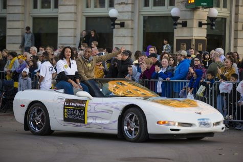 Grand Marshal J.P. Armstrong rides in a Corvette during the 2019 Homecoming Parade on Oct. 18 in Downtown Iowa City.