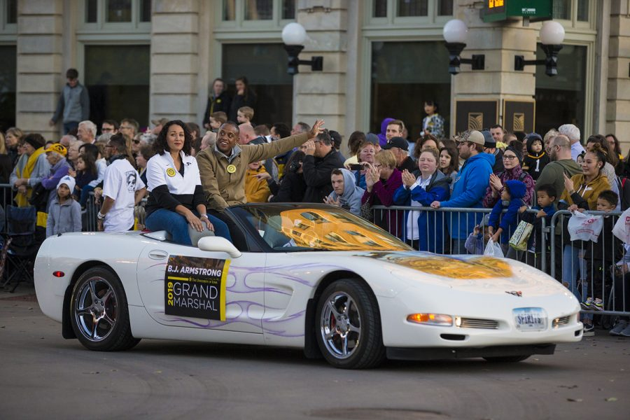 Grand Marshal BJ. Armstrong rides in a Corvette during the 2019 Homecoming Parade on Oct. 18 in Downtown Iowa City.