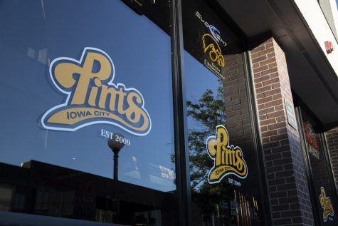 The front window of Pints is seen on June 25 in Iowa City. (Jake Maish/The Daily Iowan)