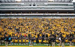 Spectators watch the action during a football game between Iowa and Middle Tennessee State at Kinnick Stadium on Saturday, September 28, 2019. The Hawkeyes defeated the Blue Raiders, 48-3.