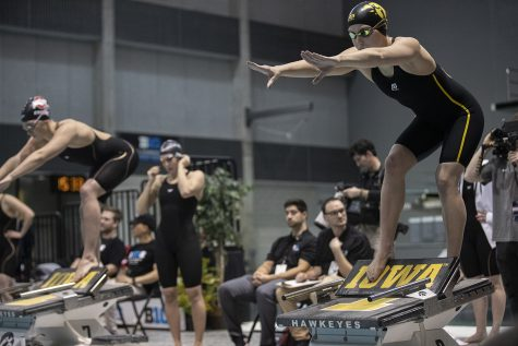 Aleksandra Olesiak awaits her turn to compete in the 400 yard medley relay during the 200 yard individual medley event at the WomenÕs Big Ten Swimming and Diving Championships on Thursday, Feb. 20, 2020 at the CRWC. Iowa finished ninth overall in the event with a time of 3:36.18.