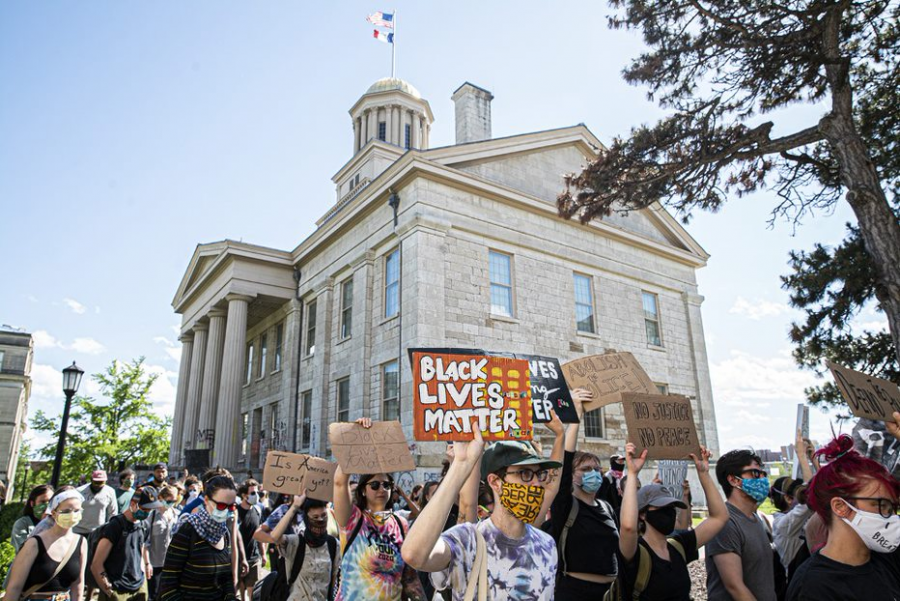 Iowa Citizens march past the Old Capitol as part of a protest on Thursday, June 11th, 2020. Iowa City, along with several major cities across the country, has been a center for protesting racism in the police force and the murder of George Floyd.